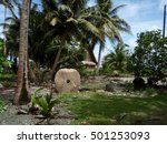 Small photo of Rai stones, better known as stone money, on the island of Yap in Micronesia. Carved in Palau and transported to Yap to be used as currency.