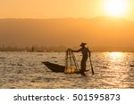 A Fisherman Pulls The Net Out...