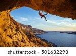 Male Climber Overhanging Rock Against - Fine Art prints