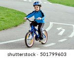 Child On A Bicycle At Asphalt...