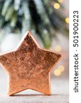 Small photo of Bronze star decoration. Holiday decorations bronze on bokeh background.