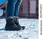 Small photo of feet shod in winter shoes