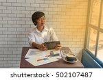 young businessmen sit across... | Shutterstock . vector #502107487