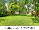 green grass and a shed in empty ... | Shutterstock . vector #502228063