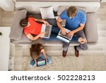 family using tablet and... | Shutterstock . vector #502228213