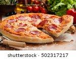salami pizza lifted 1 slice | Shutterstock . vector #502317217