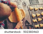 child rolling out dough for... | Shutterstock . vector #502383463