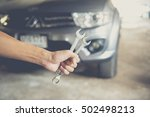 hand holding wrench.  auto... | Shutterstock . vector #502498213