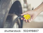 close up checking car tyre... | Shutterstock . vector #502498807