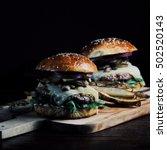 burger with mushrooms  arugula  ... | Shutterstock . vector #502520143