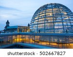 Stock photo illuminated glass dome on the roof of the reichstag in berlin in the late evening 502667827