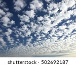 Small photo of Clouds on a blue sky, altocumulus flocus