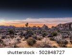 Desert Scene At Sunset During...
