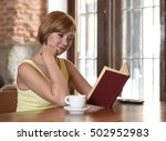 young pretty woman enjoying... | Shutterstock . vector #502952983
