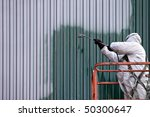 A Commercial Painter On An...