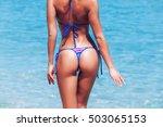 woman in bikini on blue sea... | Shutterstock . vector #503065153