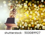 win concept man holding up a... | Shutterstock . vector #503089927