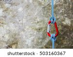 Red Carabiner With Climbing...