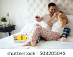 couple relaxing in pajamas and... | Shutterstock . vector #503205043