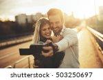 tourist couple taking selfies...   Shutterstock . vector #503250697
