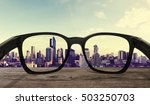 sunglasses on wooden desk with... | Shutterstock . vector #503250703