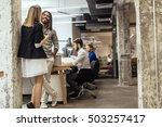 business colleagues talking in... | Shutterstock . vector #503257417