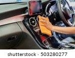 hand with orange microfiber... | Shutterstock . vector #503280277
