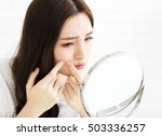 young woman squeeze her acne in ... | Shutterstock . vector #503336257