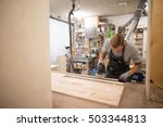 tattoed man polishes boards.... | Shutterstock . vector #503344813