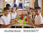 Kids At A Table In A Primary...