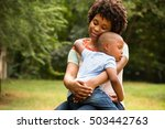 mother holding her sleeping... | Shutterstock . vector #503442763