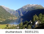 Tranquil scene in Norwegian Geiranger Fjord - stock photo