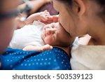 unrecognizable parents holding... | Shutterstock . vector #503539123