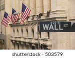 Wall Street Sign In Front Of...