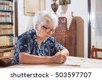 elderly woman with eyeglasses... | Shutterstock . vector #503597707