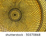 An intricate design on a handmade plate in Marrakech. - stock photo