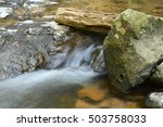 Small Stream Flows Under The...