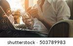 man using smartphone and laptop ... | Shutterstock . vector #503789983