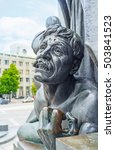 Small photo of KHARKOV, UKRAINE - MAY 20, 2016: The sculptures of dying Gaydamak (poem character) with the agony on his face at the foot of Taras Shevchenko Monument, on May 20 in Kharkov.