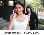 beautiful young woman talking... | Shutterstock . vector #503921293