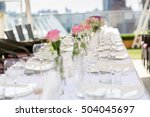 row of vases with flowers on... | Shutterstock . vector #504045697