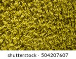 Small photo of green shag carpet background detail with long yarn