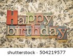 Small photo of Happy Birthday greeting card - word abstract in letterpress wood type against amate paper