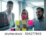 colleagues using sticky notes... | Shutterstock . vector #504277843