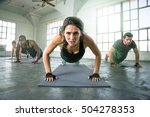 Stock photo athletic group of fit multi ethnic people exercising with vigor vitality passion 504278353