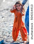 Small photo of KOS, GREECE, CIRCA OCTOBER 2015. Fariba, 3 years old Afghan baby girl at the coast of Kos. She and her family arrived to Kos in a dinghy from Turkey the same day early in the morning in a dinghy.