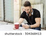 young man using a smartphone... | Shutterstock . vector #504368413