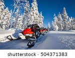 Group Of Red Snowmobiles In...