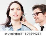 Small photo of otolaryngology Doctor Inspecting the ear canal and eardrum during an ENT exam