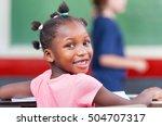 cheerful african girl smiling...   Shutterstock . vector #504707317